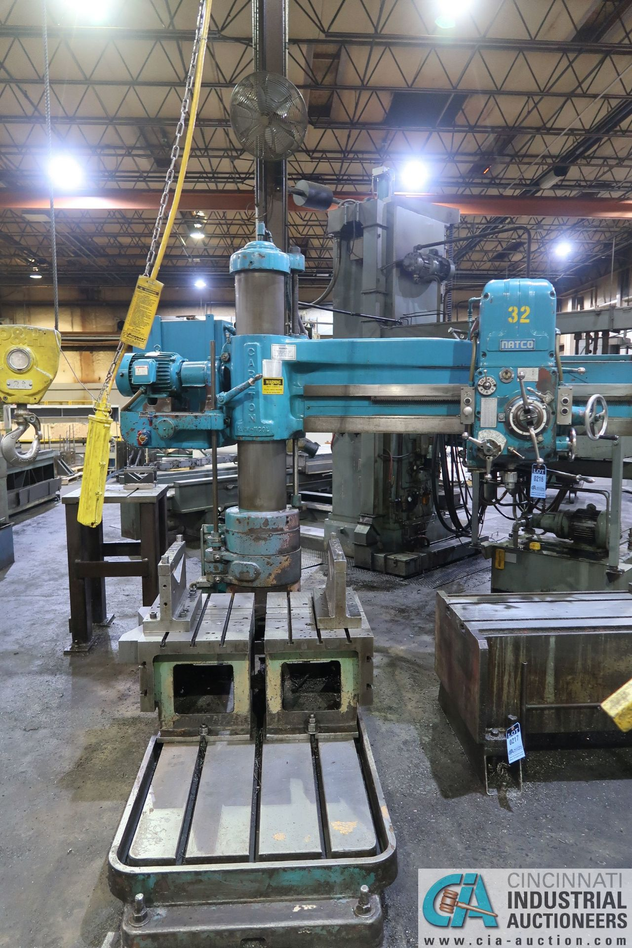 "5' ARM X 11"" COLUMN CARLTON RADIAL ARM DRILL; S/N 4434, WITH (2) 18"" X 28"" X 17"" HIGH T-SLOTTED"