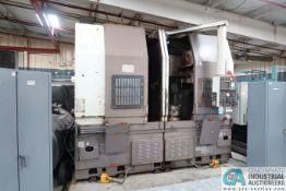**DOOSAN DOOTURN MODEL 2SP-V5 DUAL SPINDLE CNC VERTICAL TURNING CENTER; S/N LTD0020, FANUC O-TT