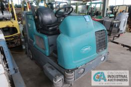 TENNANT MODEL M20 LP GAS SIT DOWN FLOOR SCRUBBER; S/N M20-7333, 3.011 HOURS (APPROX.) SHOWING