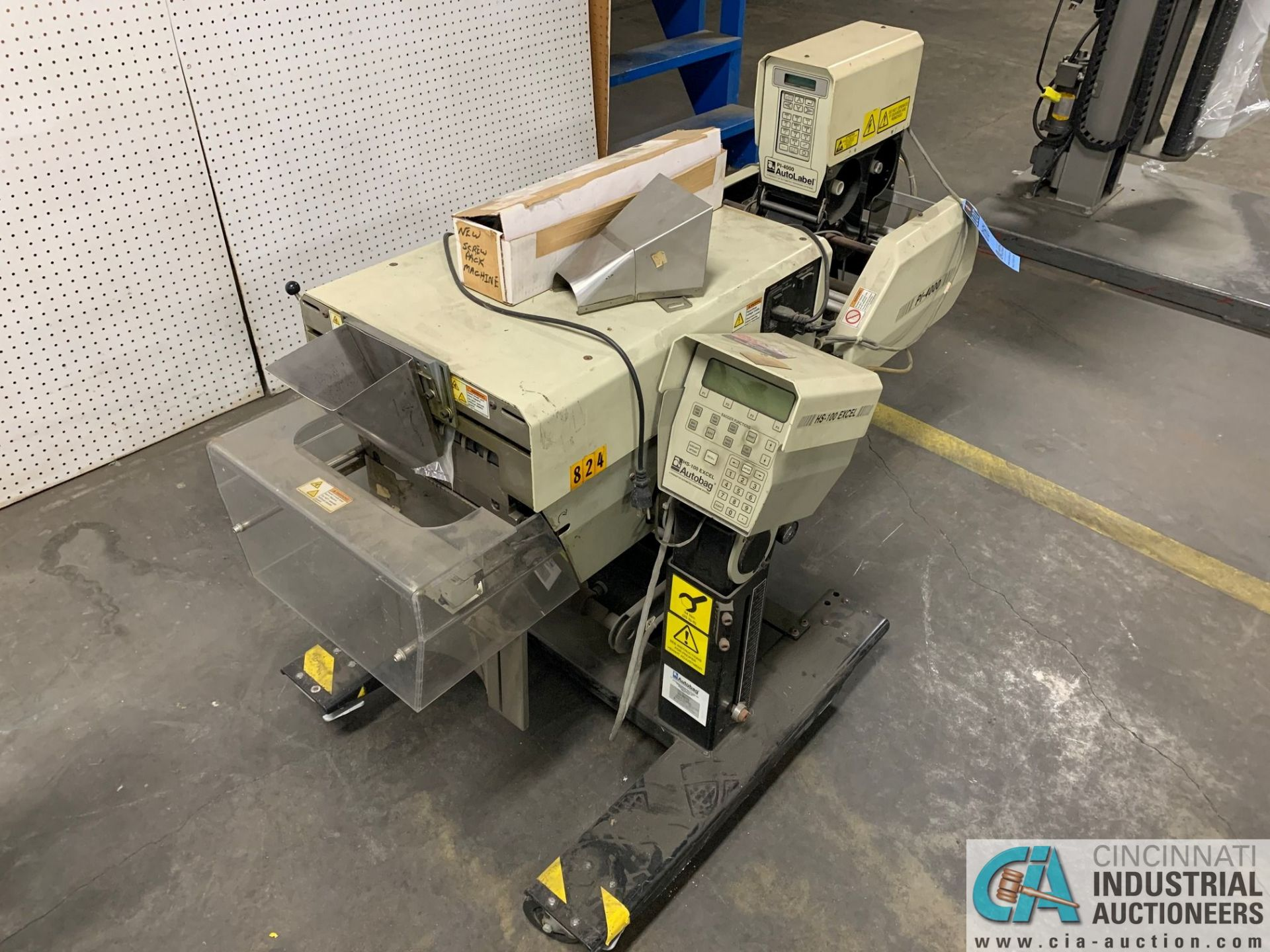 AUTOBAG MODEL HS-100 EXCEL POLY BAGGING MACHINE; S/N 2072896019, WITH P1-4000 AUTO LABEL MACHINE (