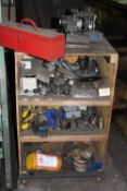 Contents of Shelf: Misc. Grinding Wheels, Grinding Wheel Hubs, Angle Vise, Precision Vise, Etc.