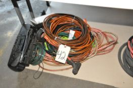 Lot-Extension Cords on Floor Under (1) Table