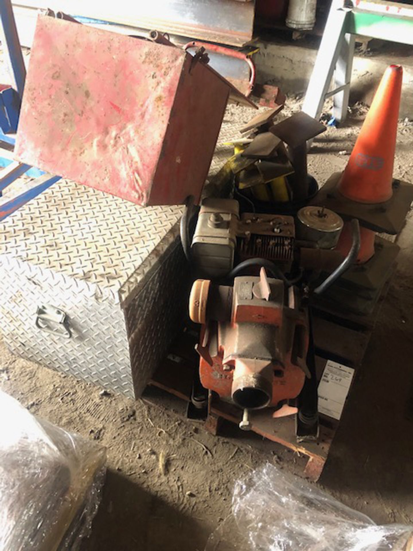 Lot 269 - skid of misc. to include a gas powered trash pump, toolbox, fertilizer spreader