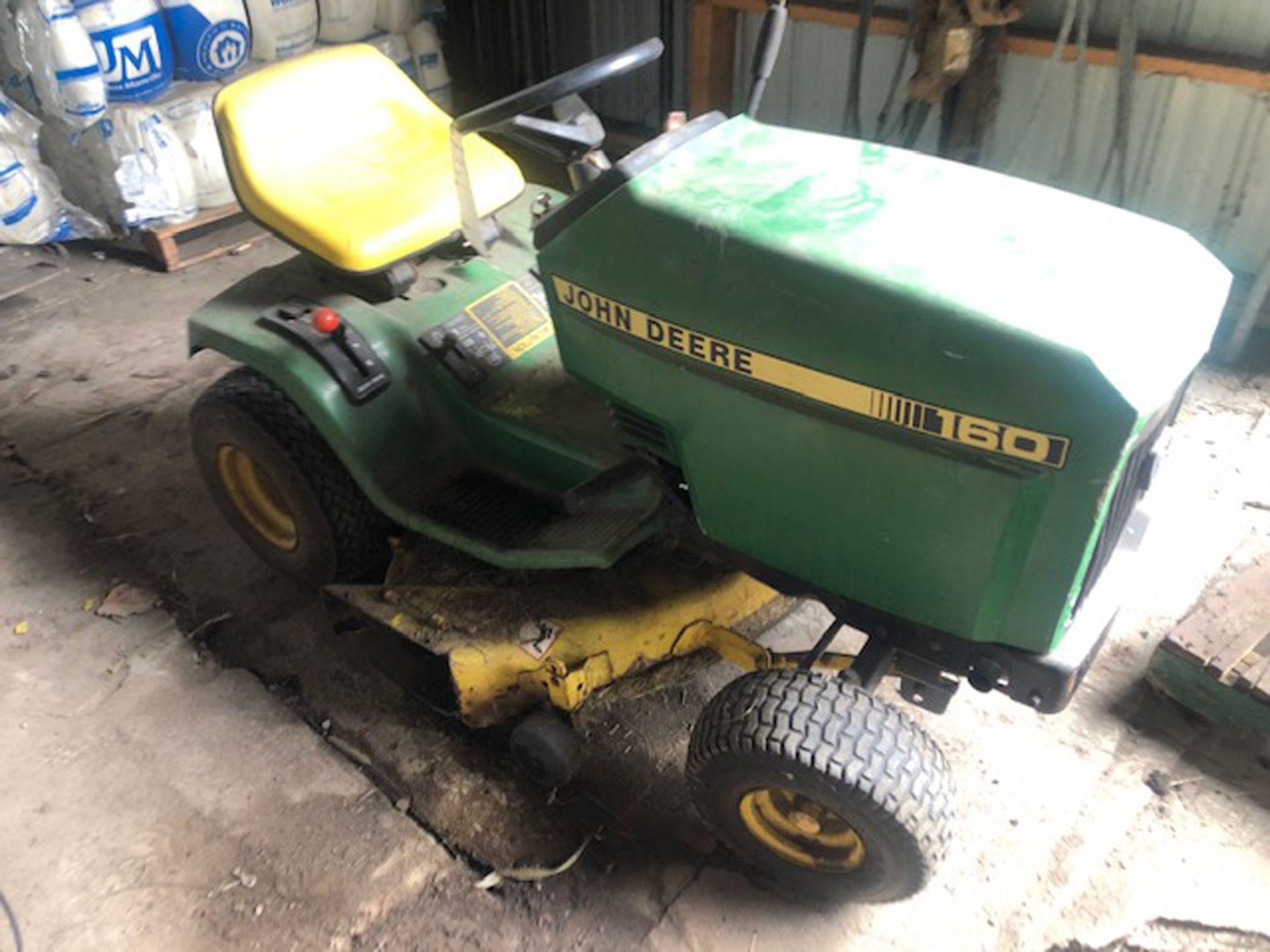 "Lot 285 - John Deere model 160 riding lawn mower gear drive with approx. 38"" dec, as is"