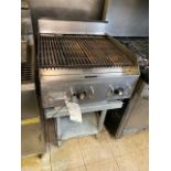 """Star Model 6024 24"""" natural gas grill sets on a support aluminum table"""