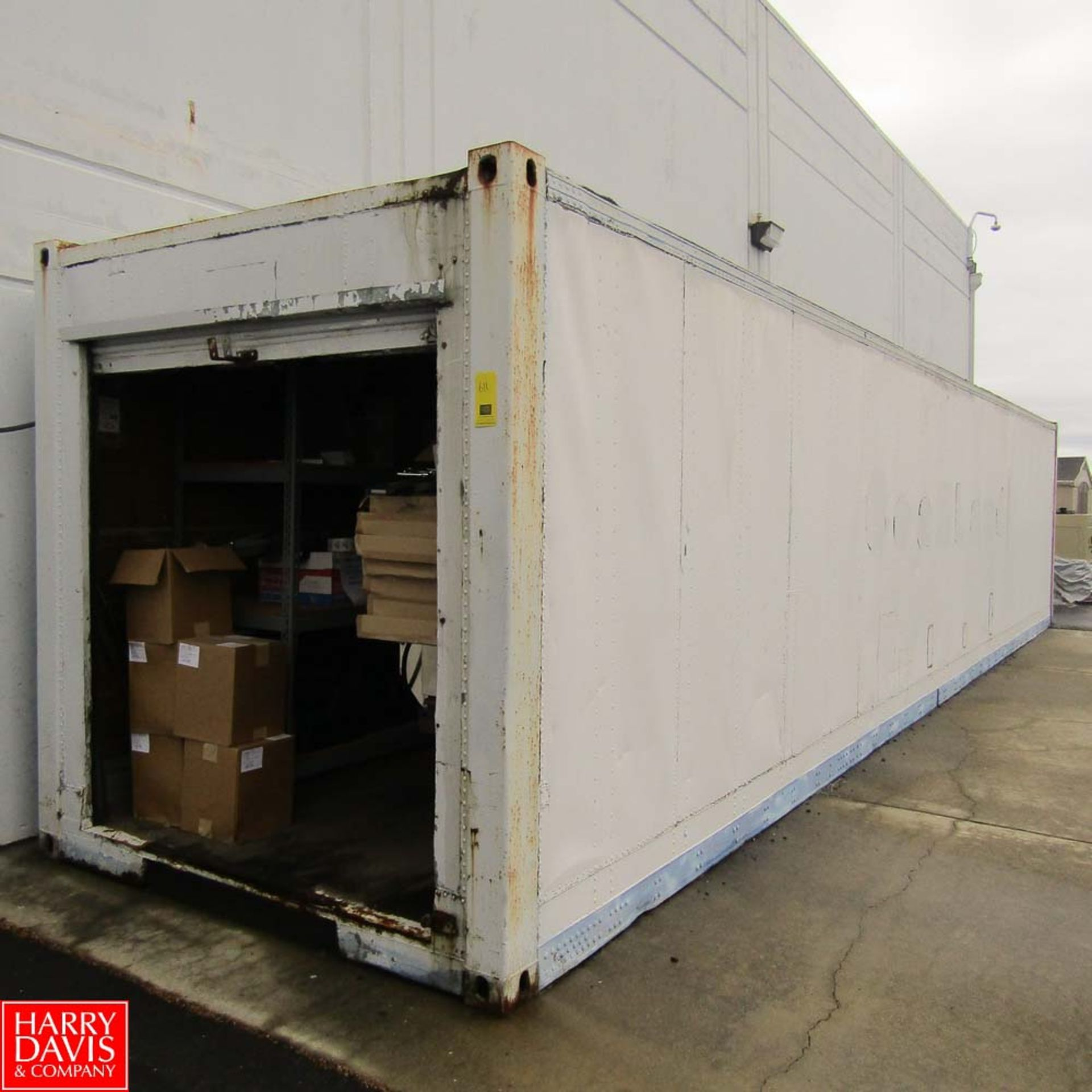 Lot 611 - 40' Shipping Container with Contents Including: Projector Screens, Grills, Tables, Water Coolers