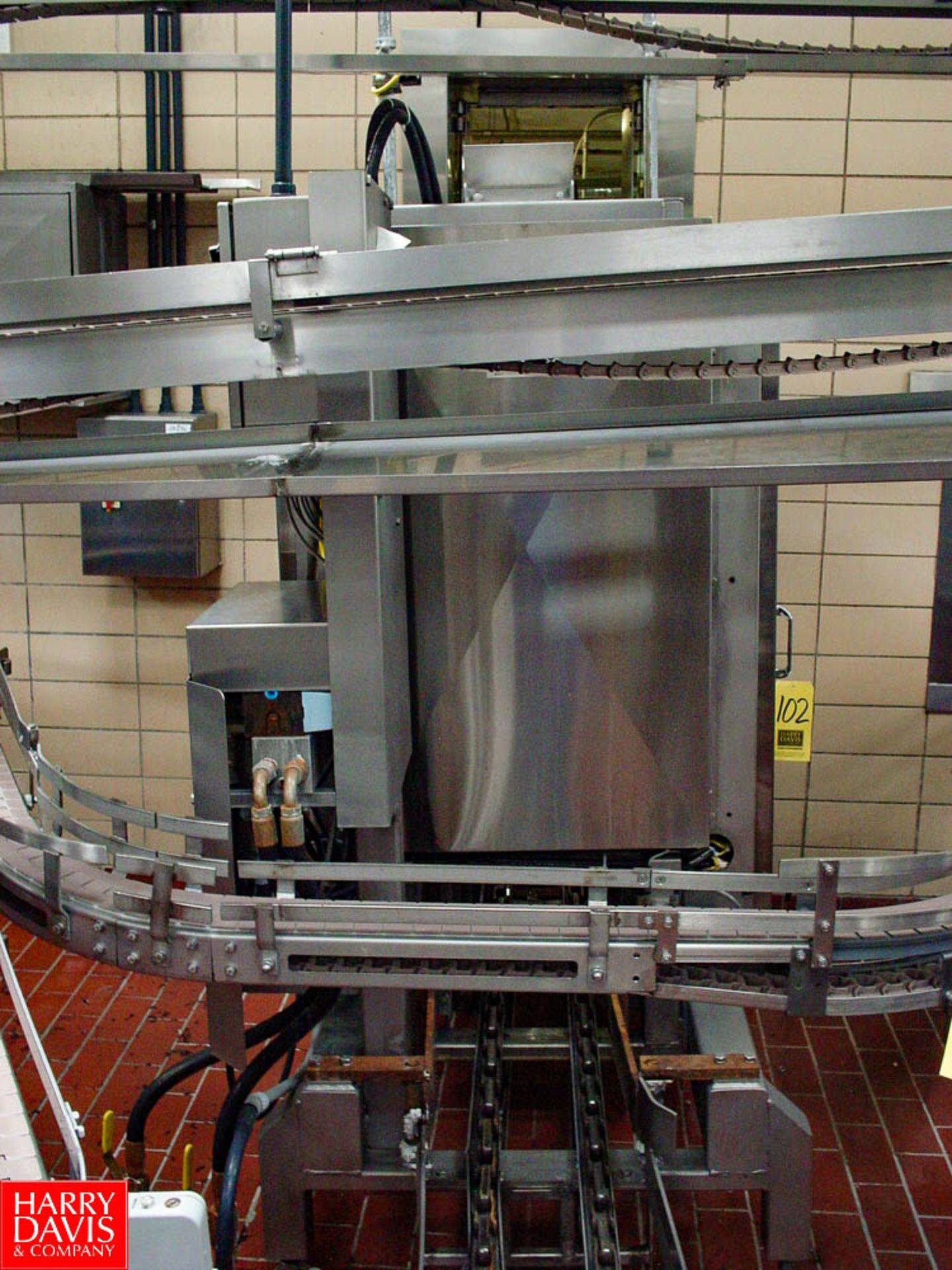 Lot 102 - DAIRY CONVEYOR STAINLESS STEEL SINGLE CASER STACKER - Rigging Fee: $ 500