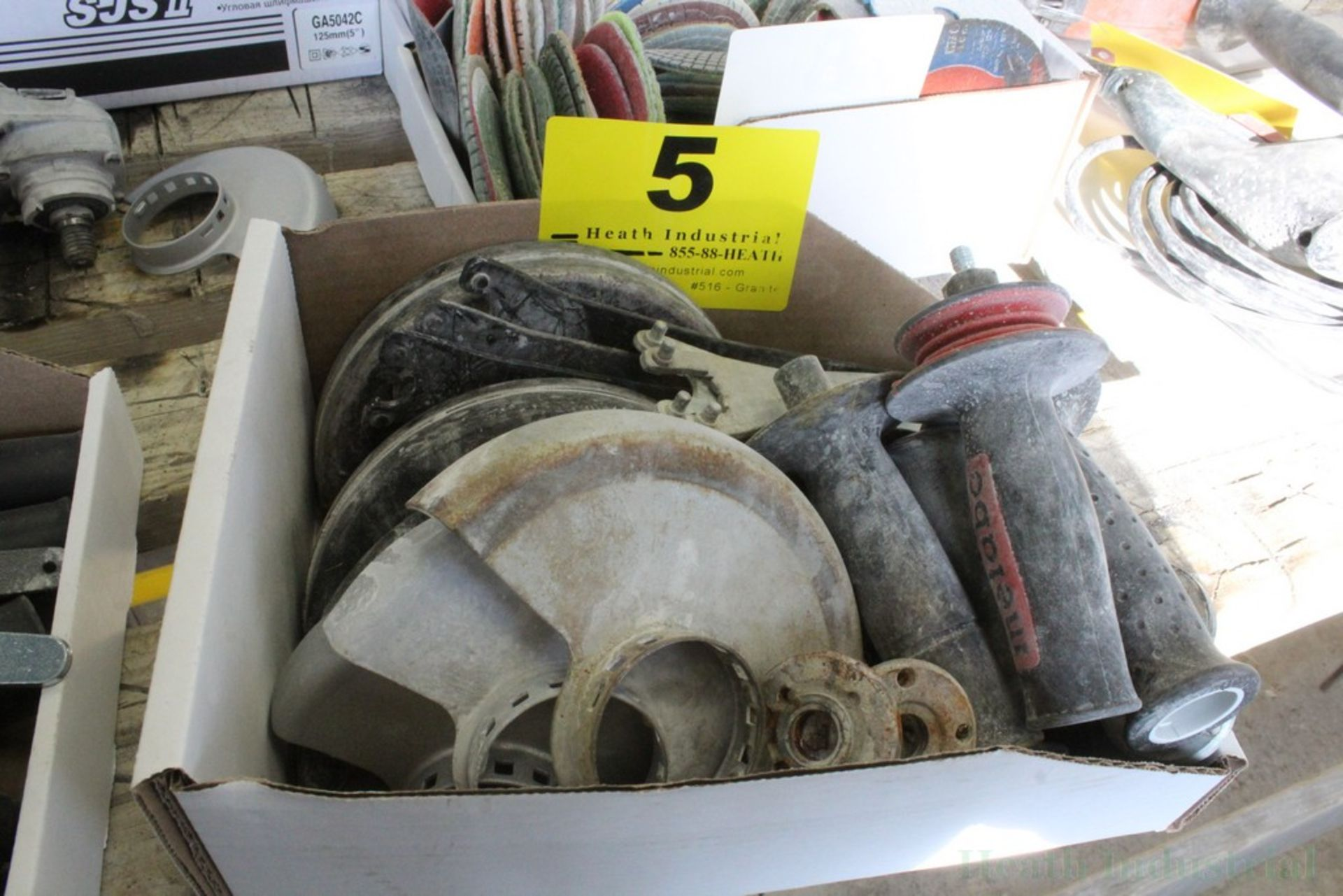 Lot 5 - ASSORTED GRINDER GUARDS, HANDLES, AND WRENCHES