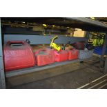 (4) GAS SAFETY CANS AND ASSORTED FUNNELS UNDER BENCH