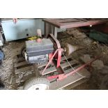 Gas power cork screw log splitter.