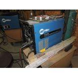 Miller Econotig AC/DC power source welder, sn KE709651.