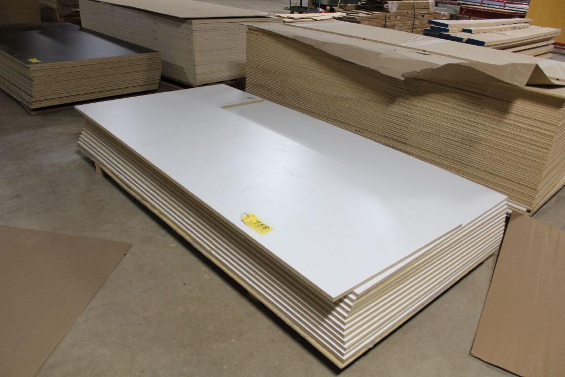 "Lot 758 - Lumber, (12) MDF white 2 sided, 3/4"" x 49"" x 97""."