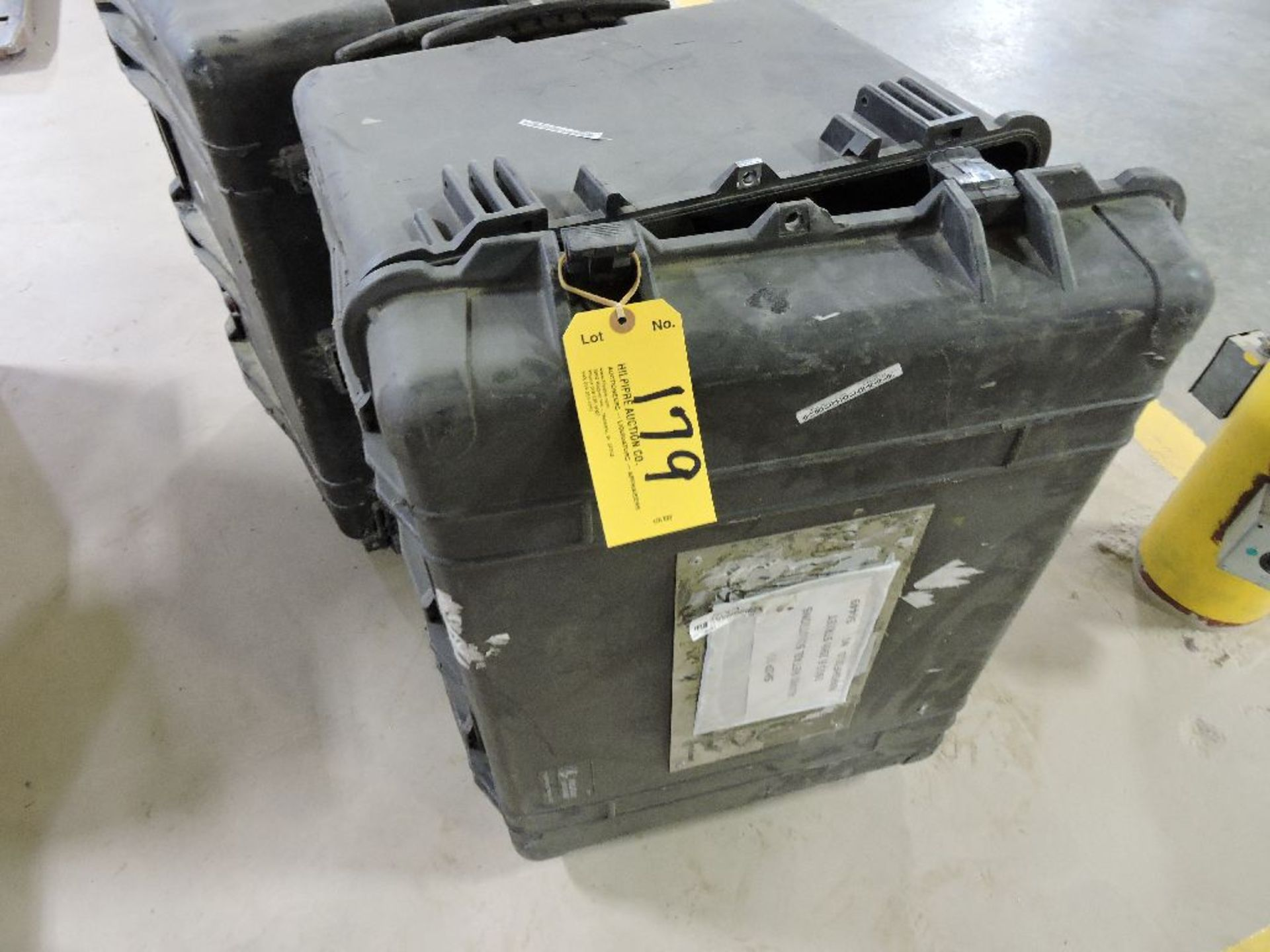 Lot 179 - Poly carrying cases.