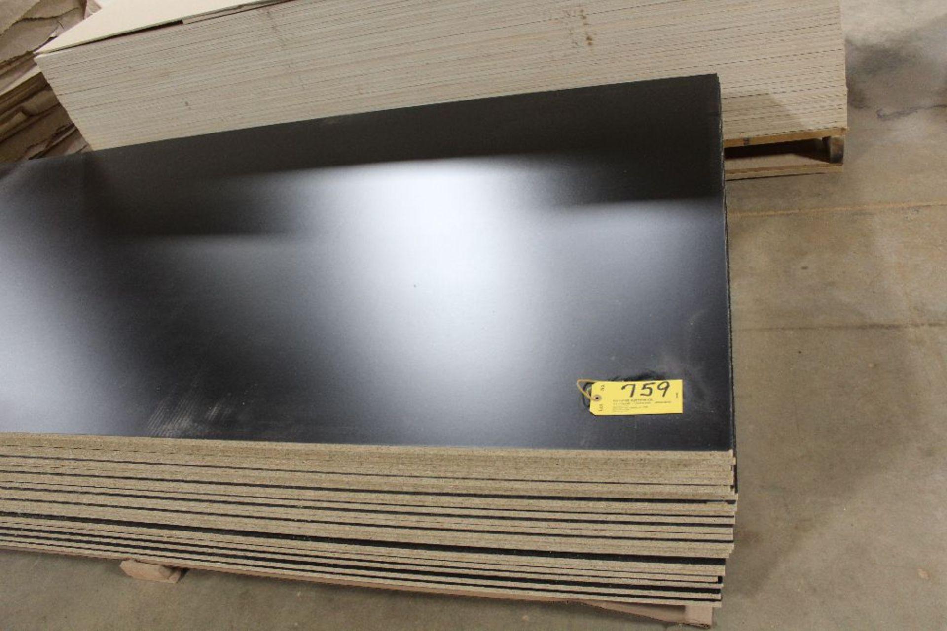 "Lot 759 - Lumber, (23) vinyl PB black 2 sided, 5/8"" x 49"" x 97""."