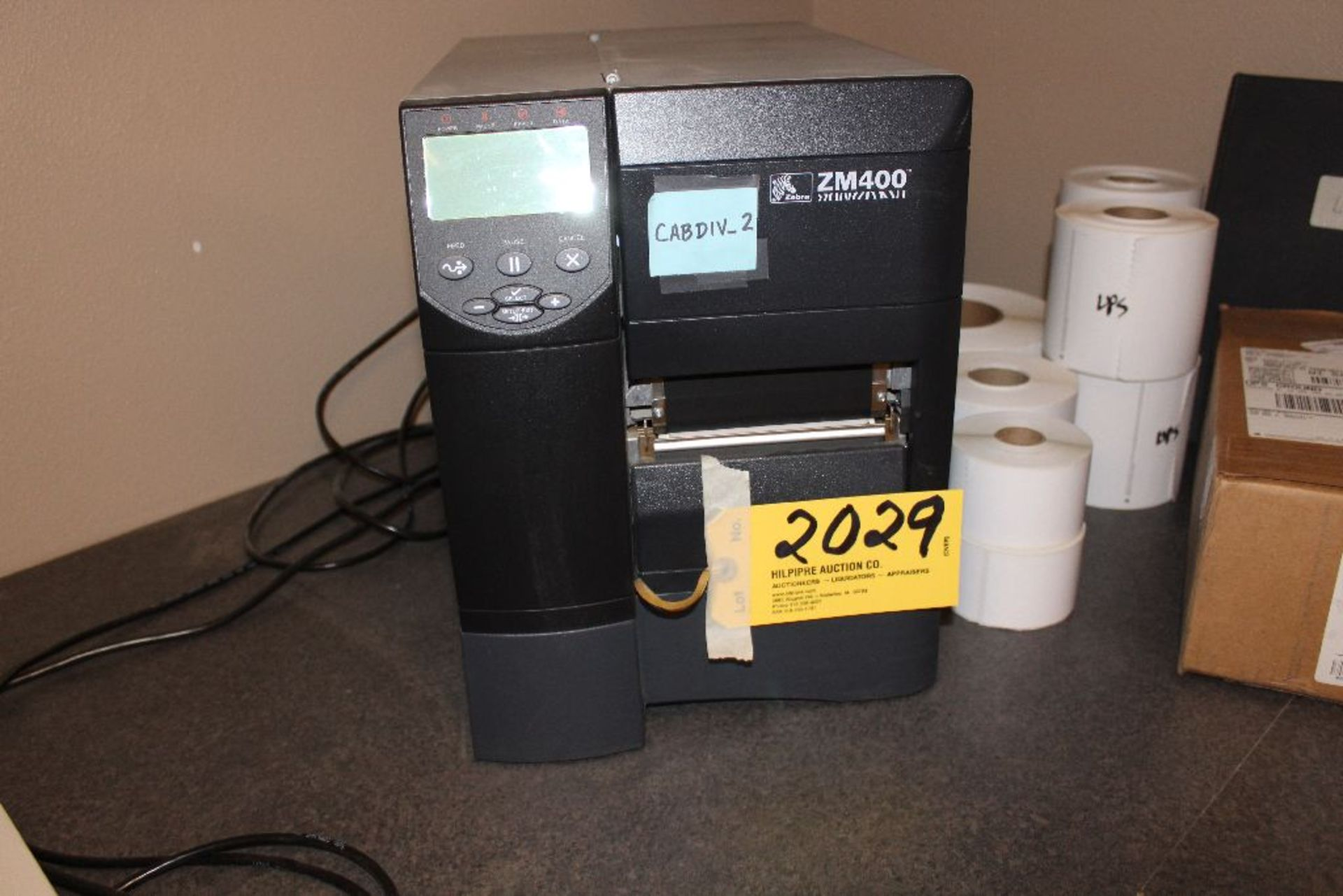 Lot 2029 - Zebra ZM400 label printer and printing label supplies.