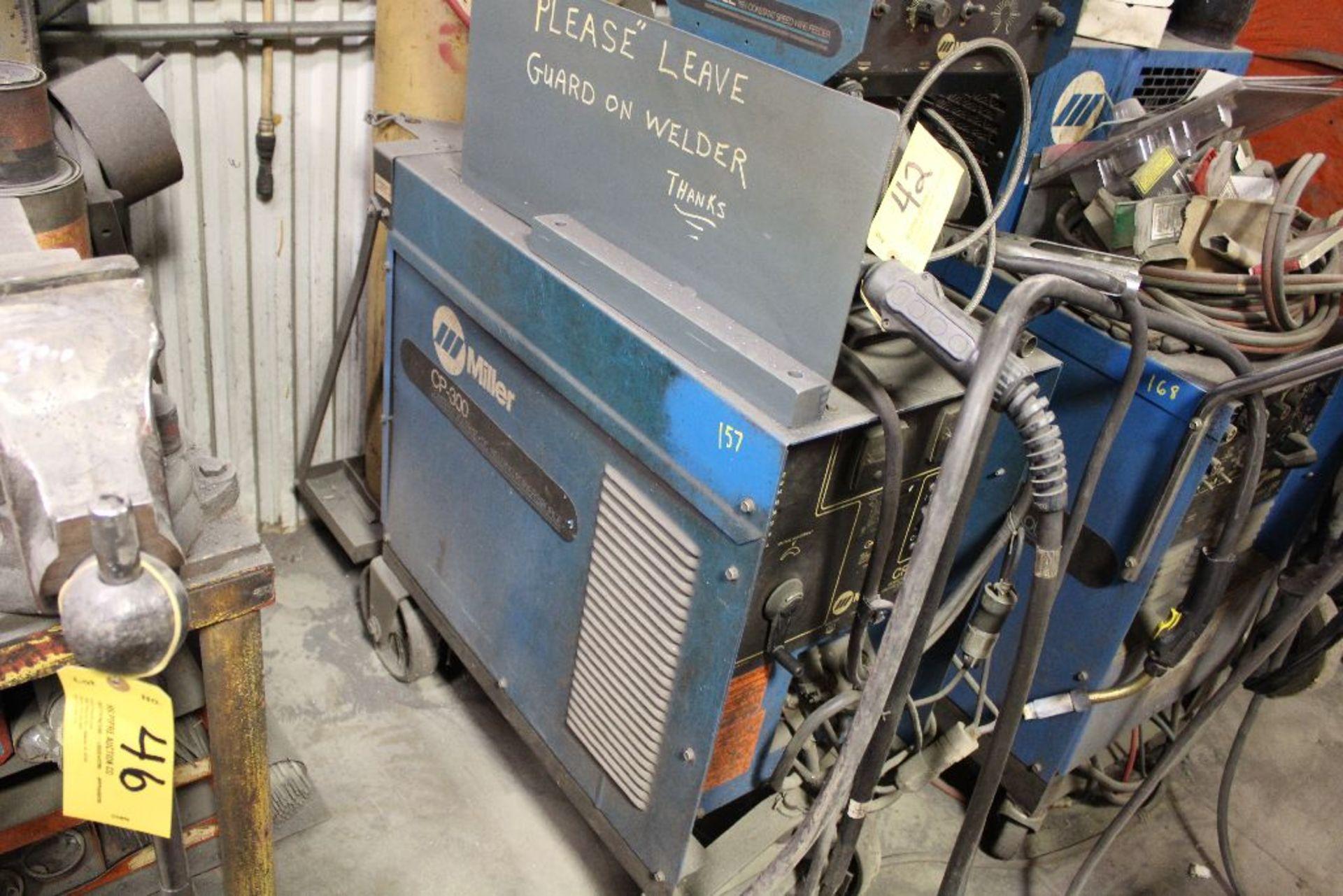 Lot 042 - Miller CP300 wire welder, sn JK605516, w/Miller S-52E wire feed, stock 902931.