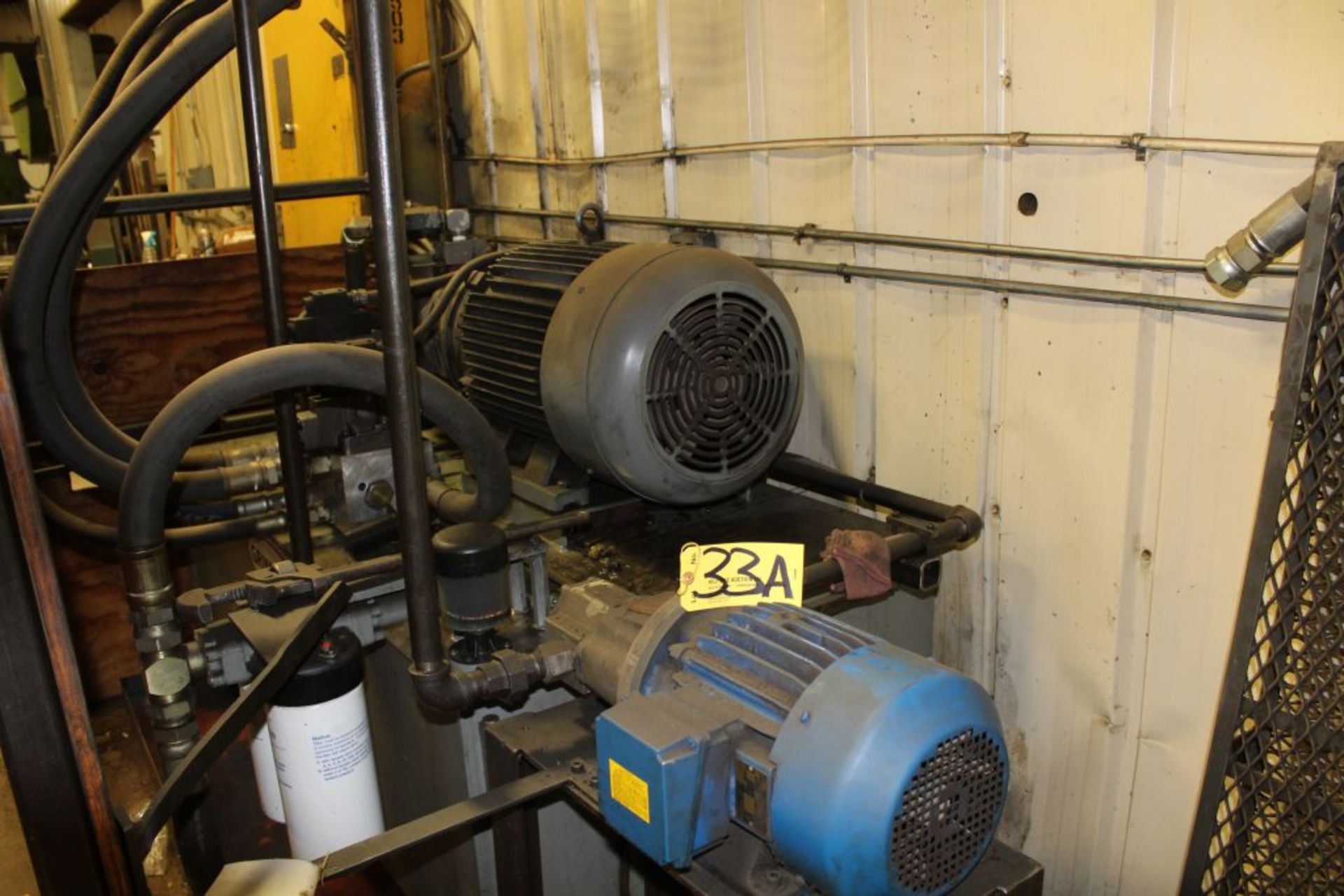 "Lot 033 - Elms hydraulic press, 600 T., 75 hp, 44 x 66"" bed, 6' pit, safety curtain."
