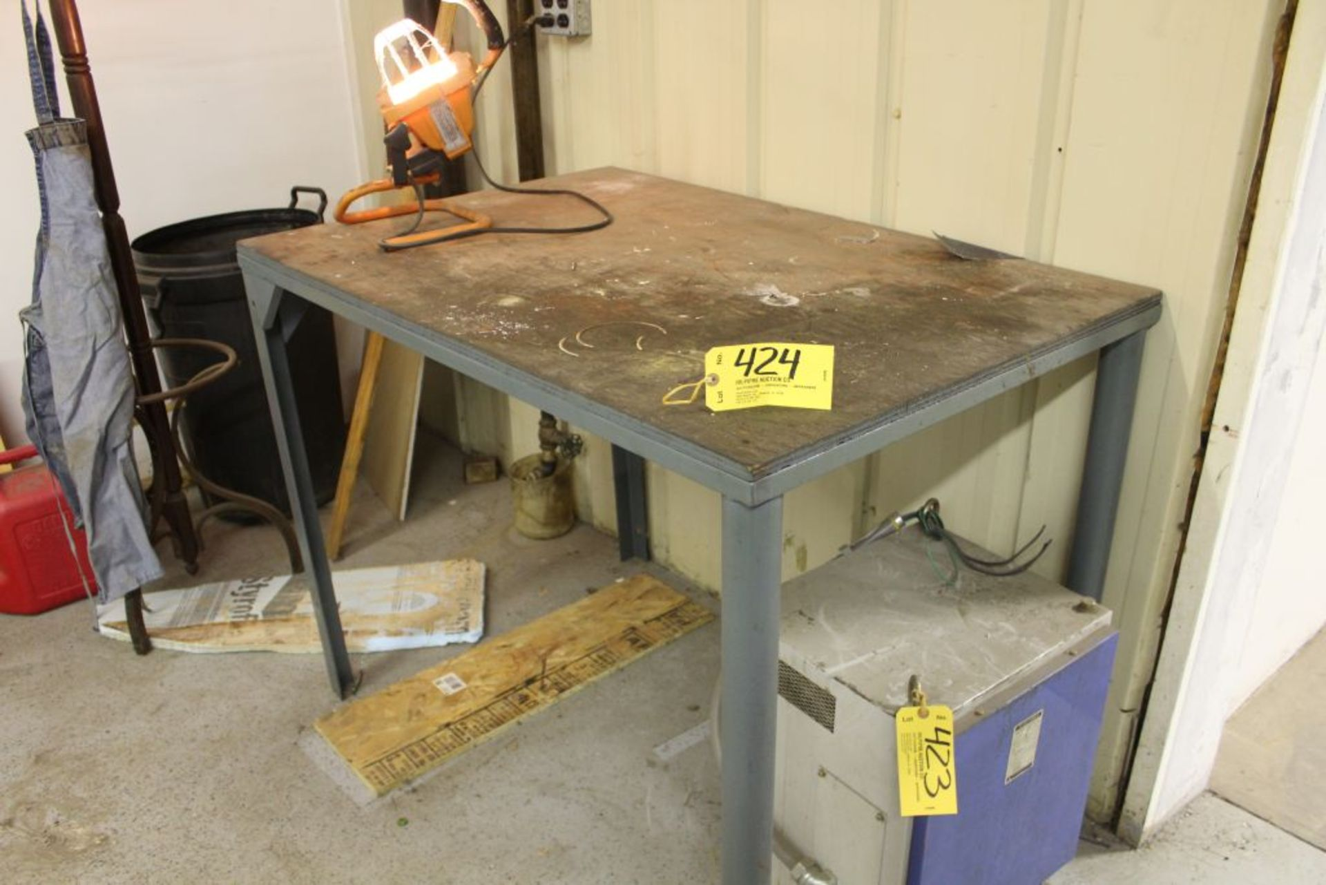 "Lot 424 - Steel fram, wood top bench, 49""x33""x38""."