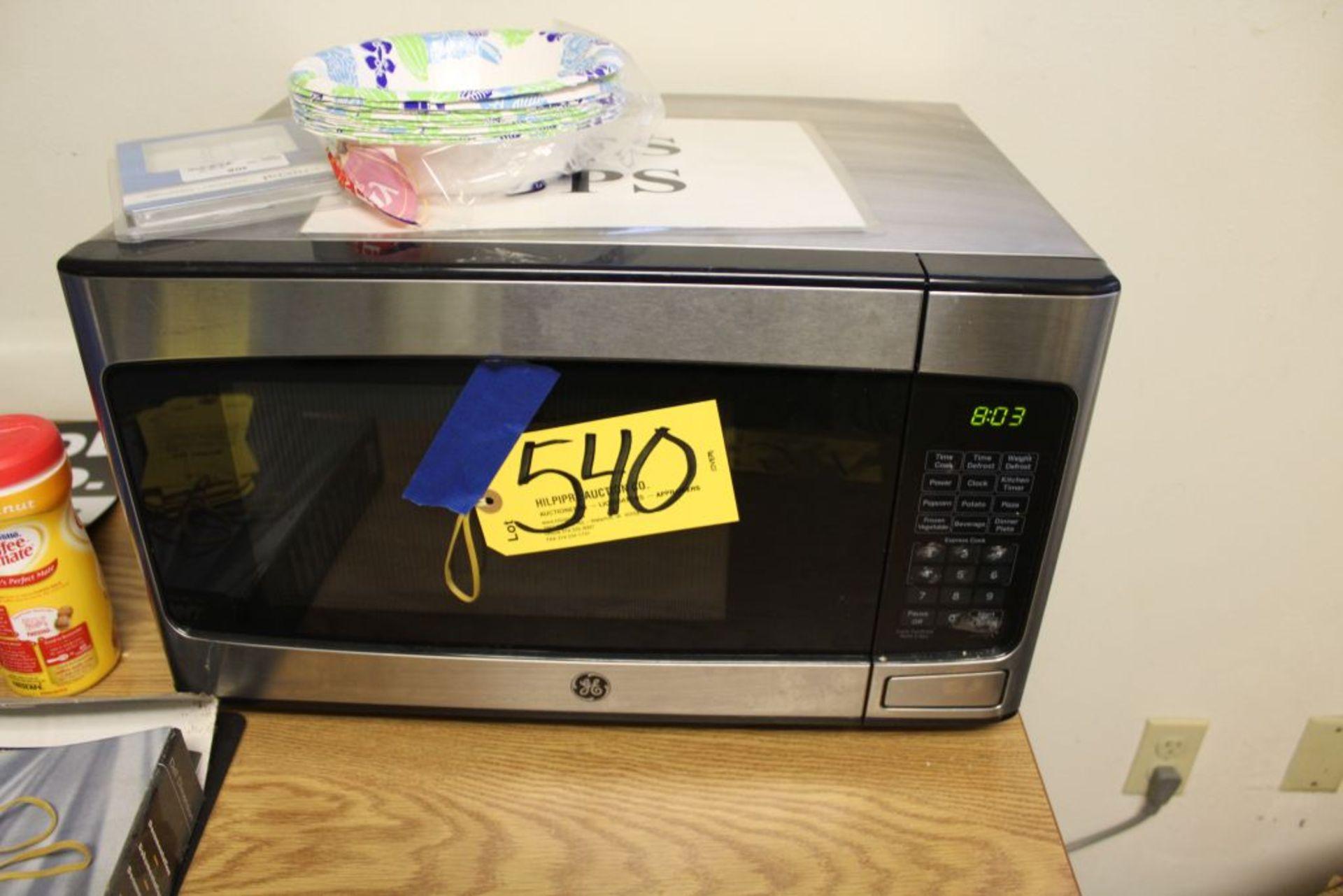 Lot 540 - G.E microwave.