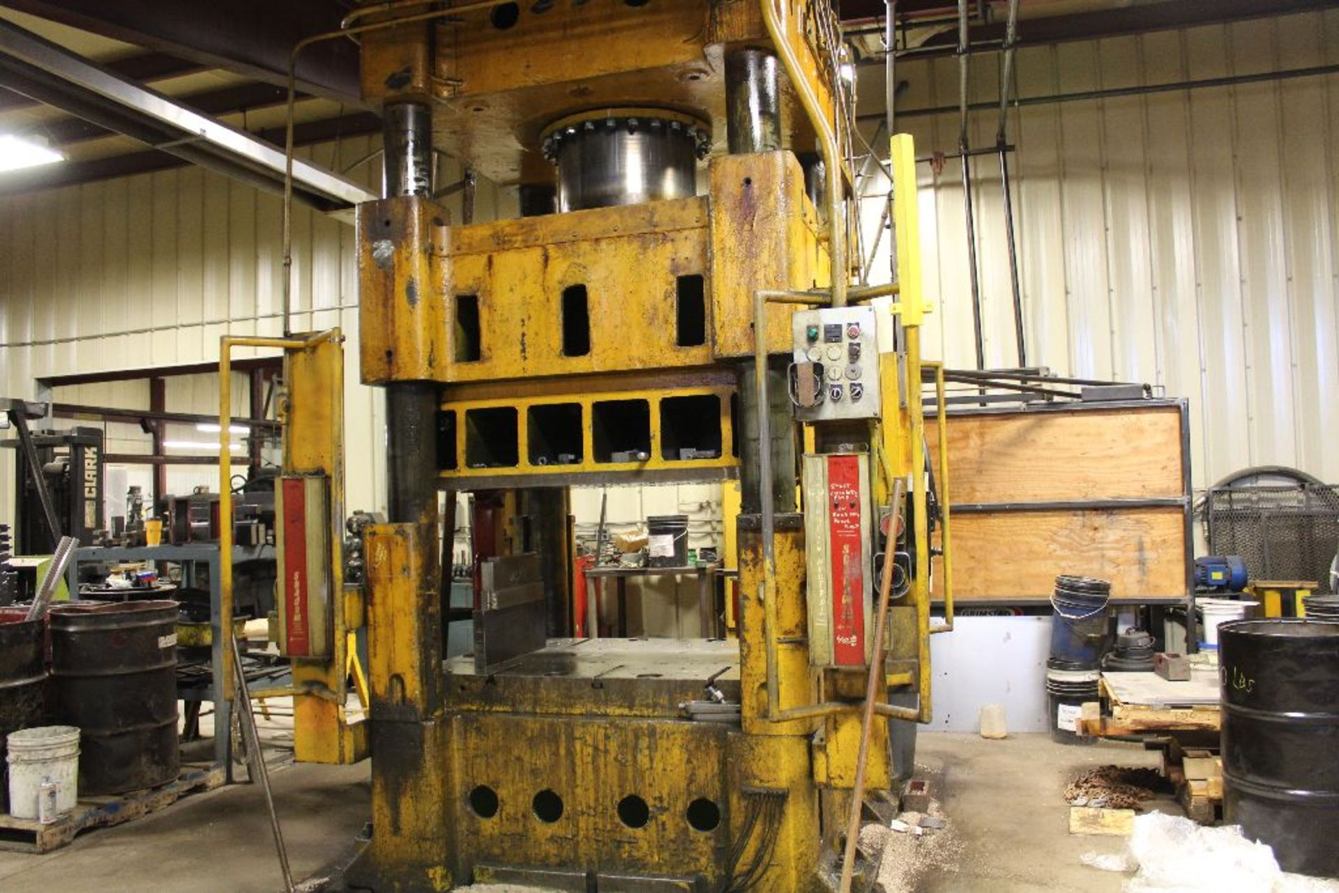 """Lot 033 - Elms hydraulic press, 600 T., 75 hp, air cushion, 44 x 66"""" bed, 6' pit, safety curtain."""