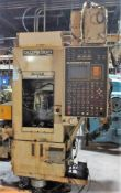 Olofsson Model SV5 Vertical CNC Chucker S/N: 13520 (1990) GE Fanuc O-T CNC Control. Loading Fee is $