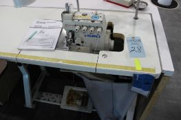 Juki model MO-6714S serging machine class BE6-40H s/n 8MOGM11231 w/Sewing Table