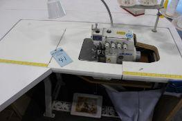 Juki model MO-6814S 4 thread overlock machine class BE6-40H s/n RM0KD01034 w/Sewing Table