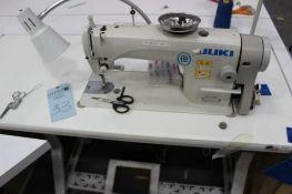 Juki model DDL-8700 sewing machine s/n 4D0KE11990 w/Sewing Table