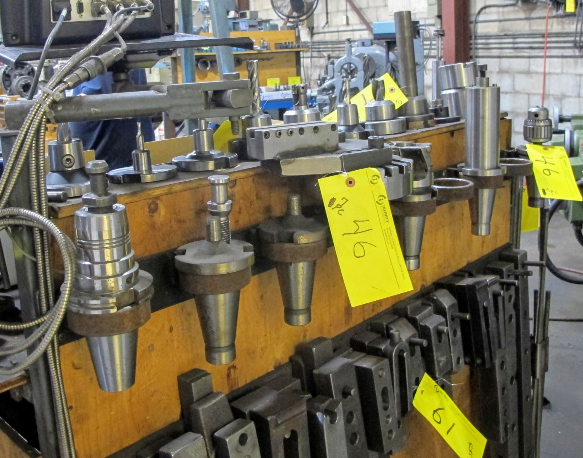 Lot 46 - LOT OF 7 CAT 50 TOOL HOLDERS W/ATTACHMENTS
