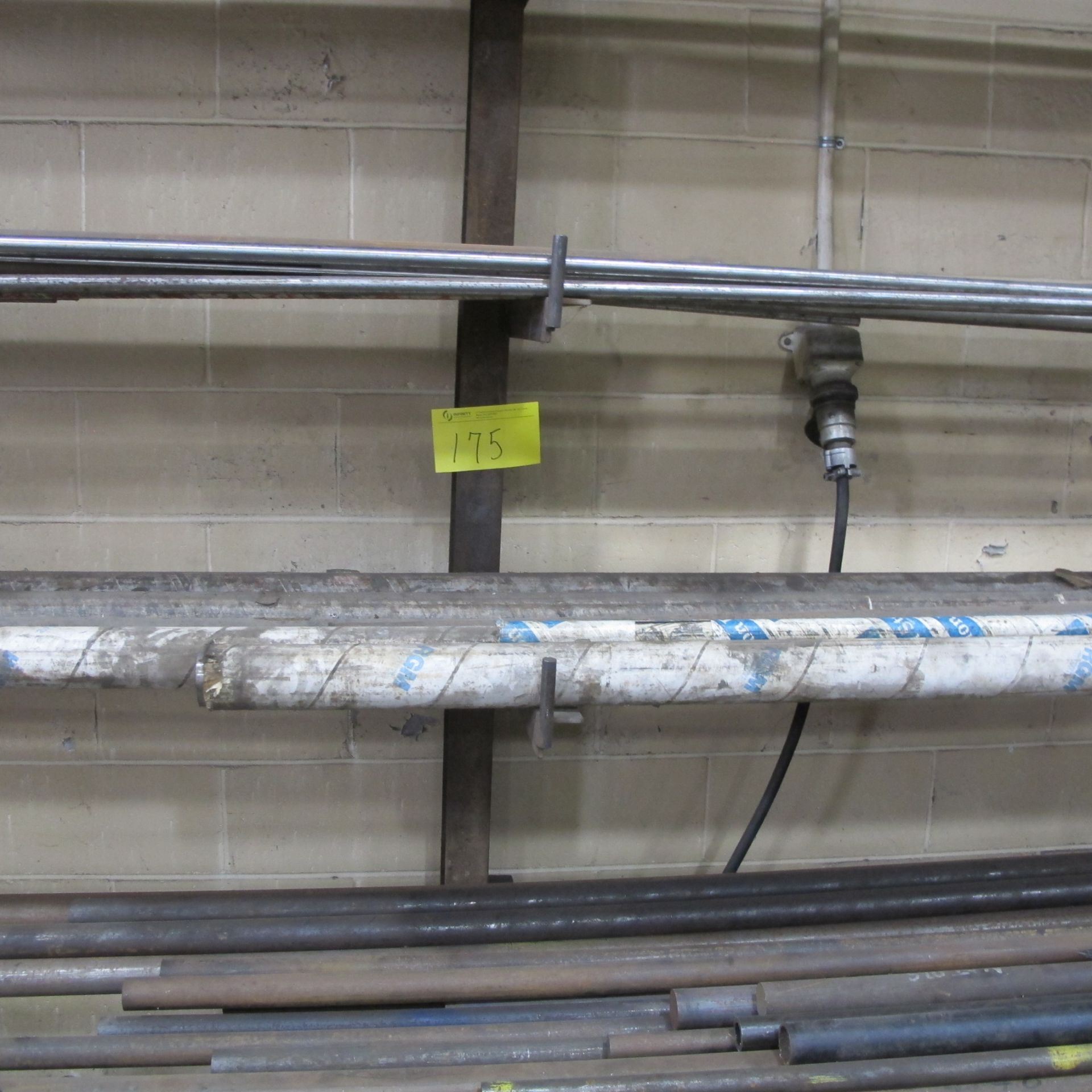 "Lot 175 - CANTELIVER STEEL RACK, 6 LEVELS W/BAR AND METAL CUTOFF STOCK (36""D X 8'T X 15'W)"