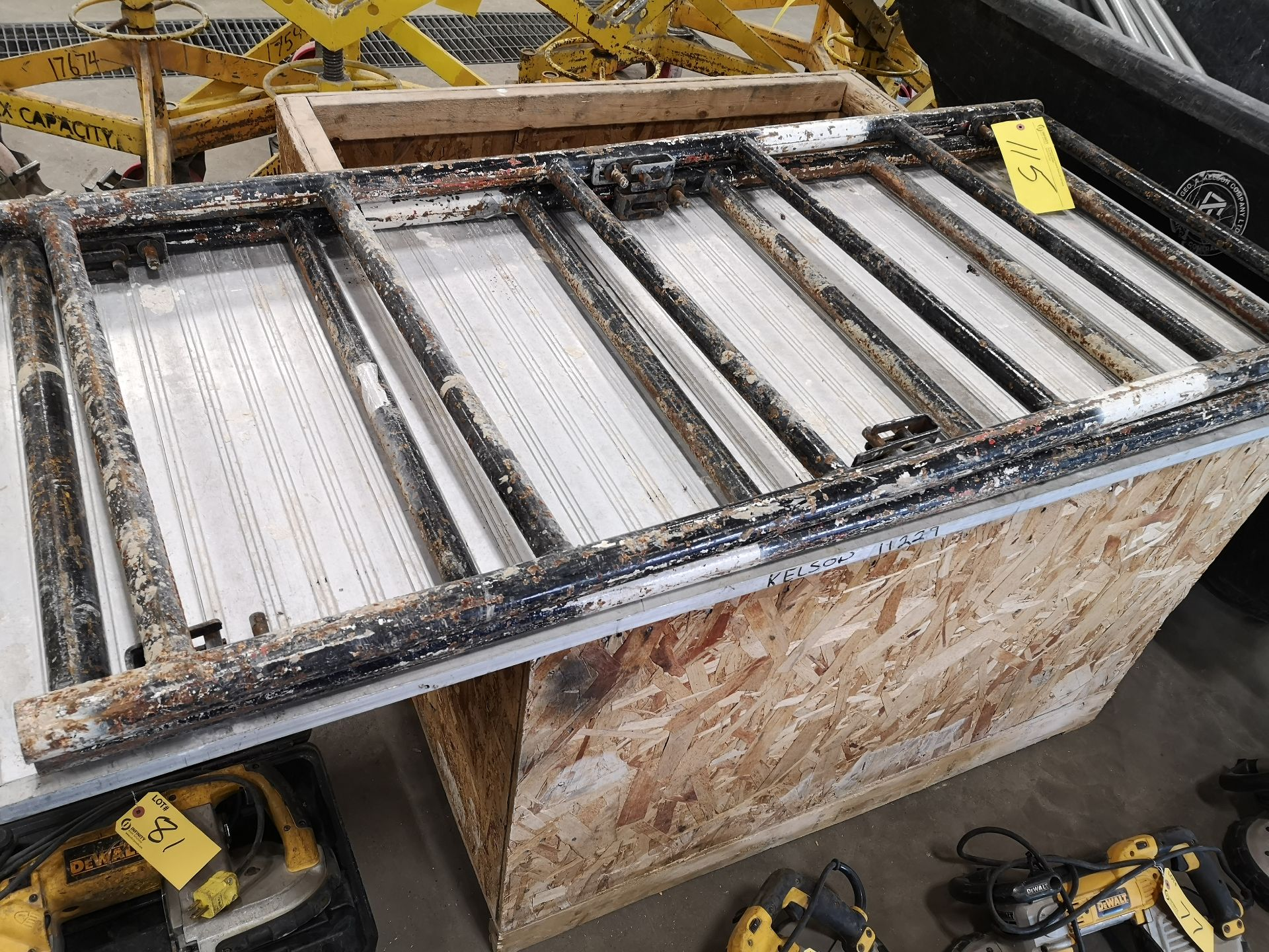 Lot 115 - LOT OF SCAFFOLD PARTS AND POLYETHYLENE ROLLING DUMPING BIN (LOCATED AT 1135 STELLAR DRIVE,