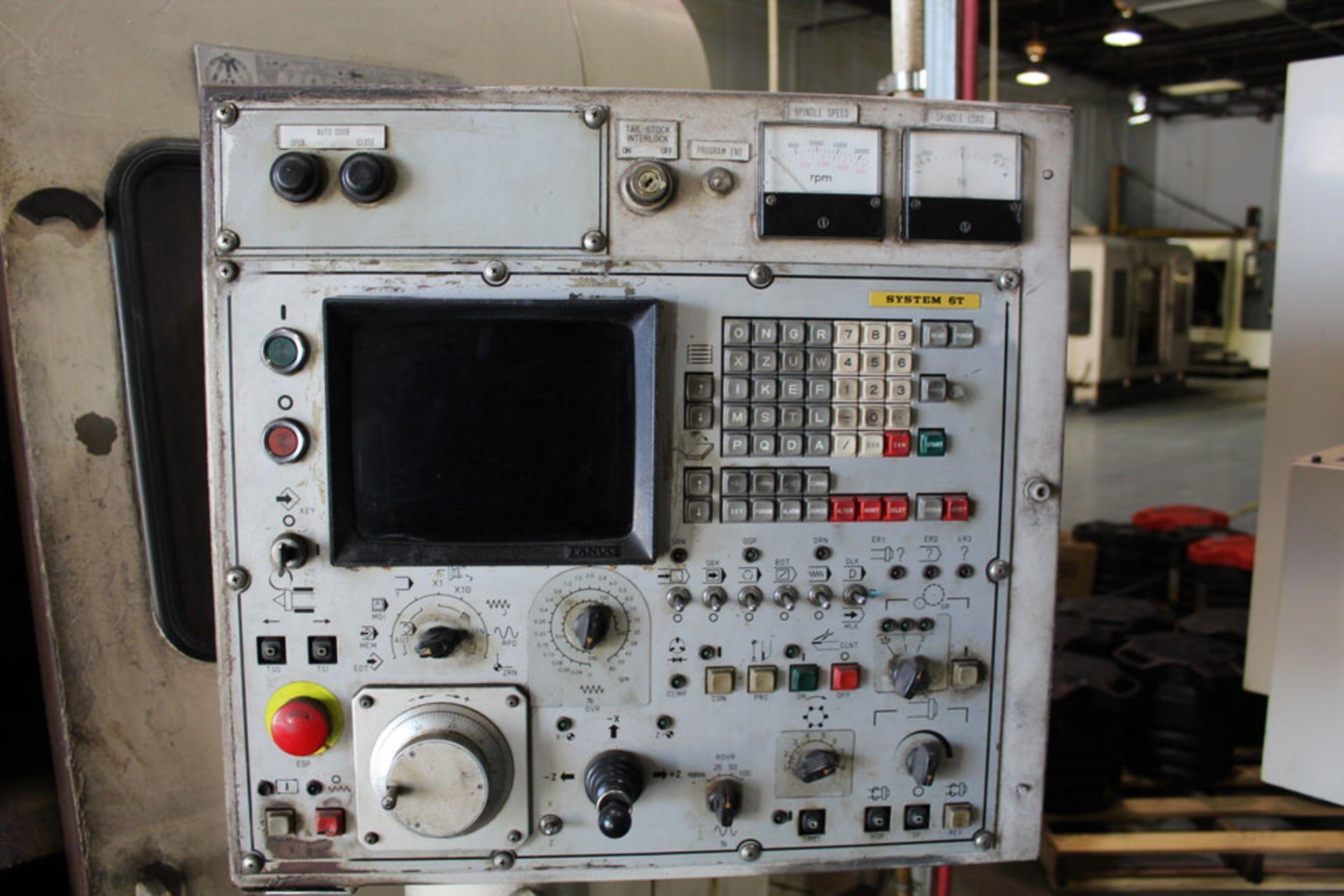 Lot 24 - MORI SEIKI SL-4 CNC LATHE W/ FANUC SYSTEM 6-T CONTROL