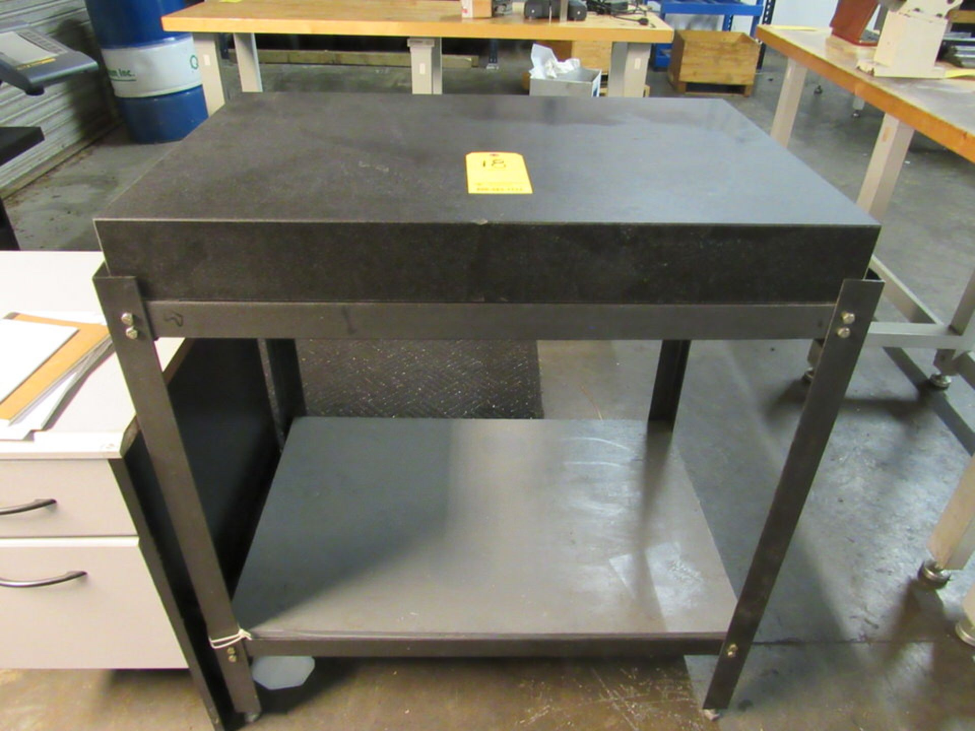 """Lot 18 - 24"""" x 36"""" x 4-1/4"""" thick Granite table on black table stand, oad: 25"""" x 37-1/2"""" x 41"""" high"""