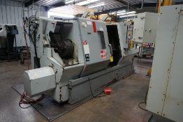 HAAS DOUBLE CHUCK SL-30B CNC LATHE W/ (2) 3 JAW CHUCK, 12 STATION TURRET & HAAS CNC CTRL