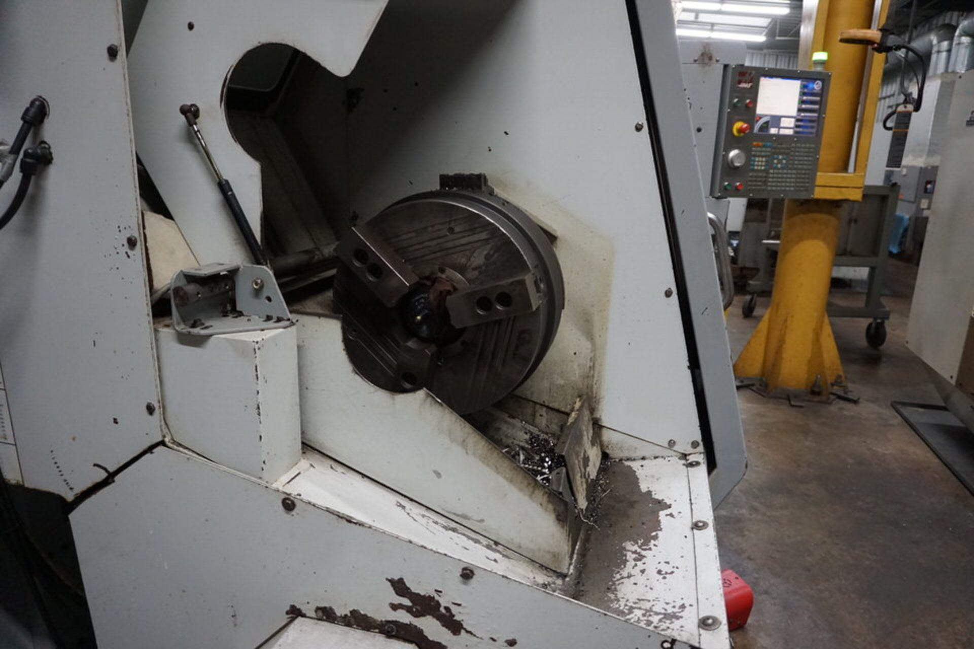 HAAS DOUBLE CHUCK SL-30B CNC LATHE W/ (2) 3 JAW CHUCK, 12 STATION TURRET & HAAS CNC CTRL - Image 4 of 6