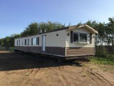 14ft x 68ft 2-Bedroom Mobile Home Kitchen Front, Fireplace in Living Room, Master Ensuite, Ext Tin