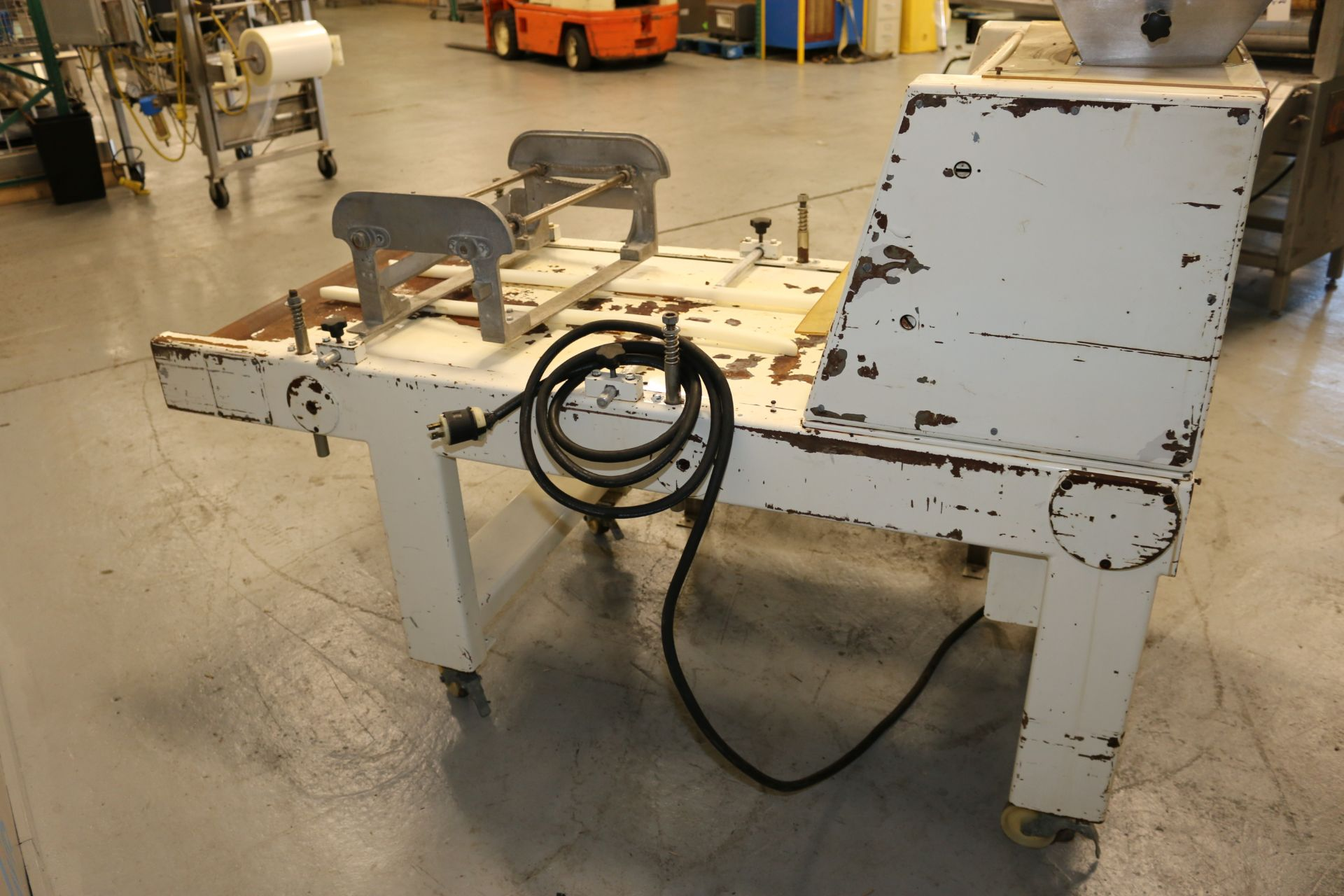 Lot 51 - Adams Equipment Corp. Double Extruder, M/N LR-67, S/N 585-83, 220 Volts, 3 Phase, with Installed