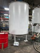 2000 Gallon Mild Steel Jacketed Mix Tank with scrape type mixing arms driven by a 5HP motor and belt