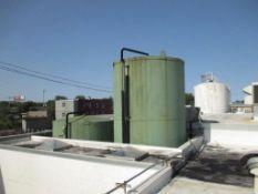 Damrow 15,000 gallon capacity refrigerated silo tank, with interior distortion. 1.5 HP horizontal