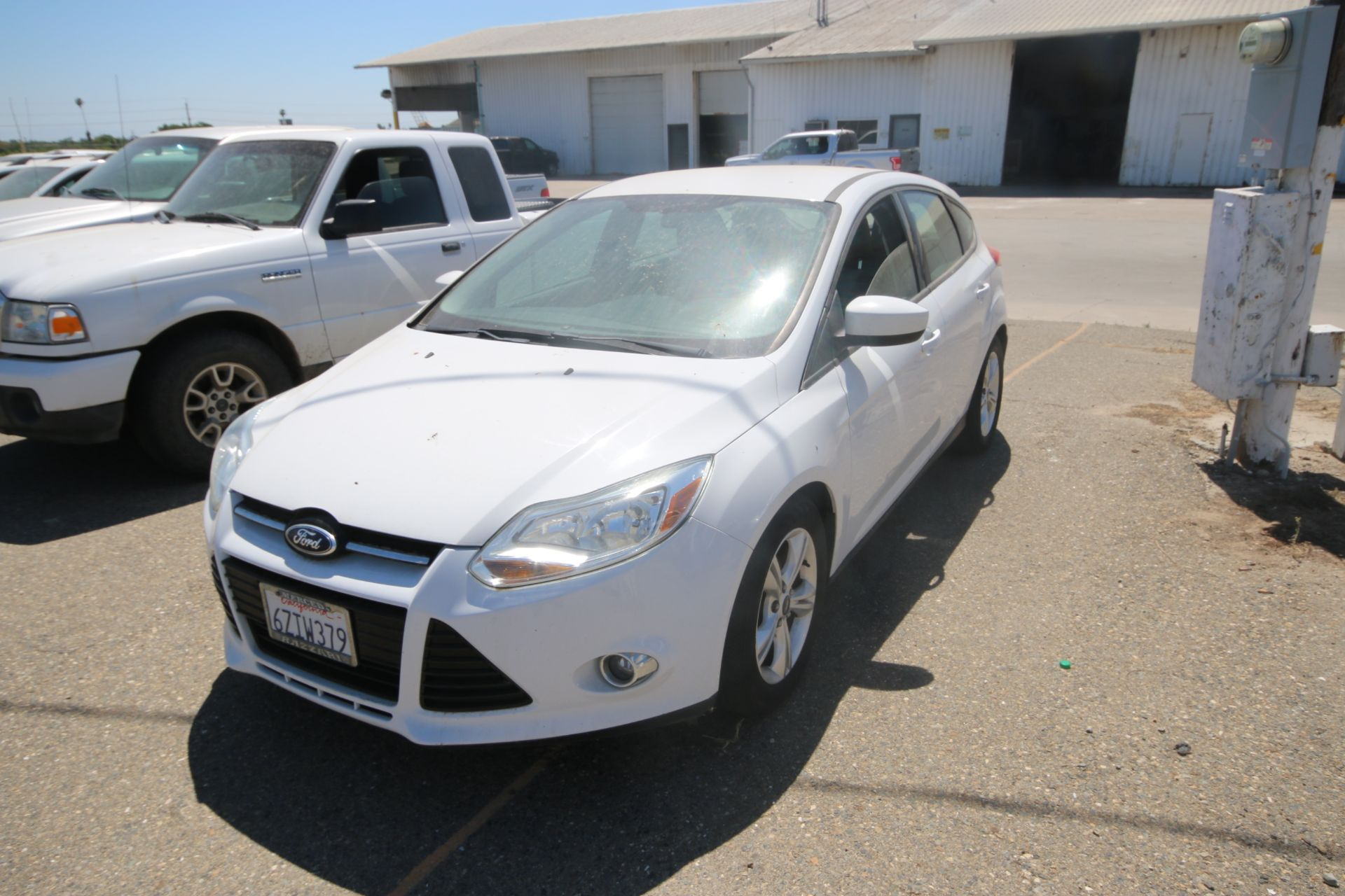 2012 White Ford Focus SE Hatchback 4D, VIN #: 1FAHP3K27CL423326, with 116,017 Miles, with 4-Doors,