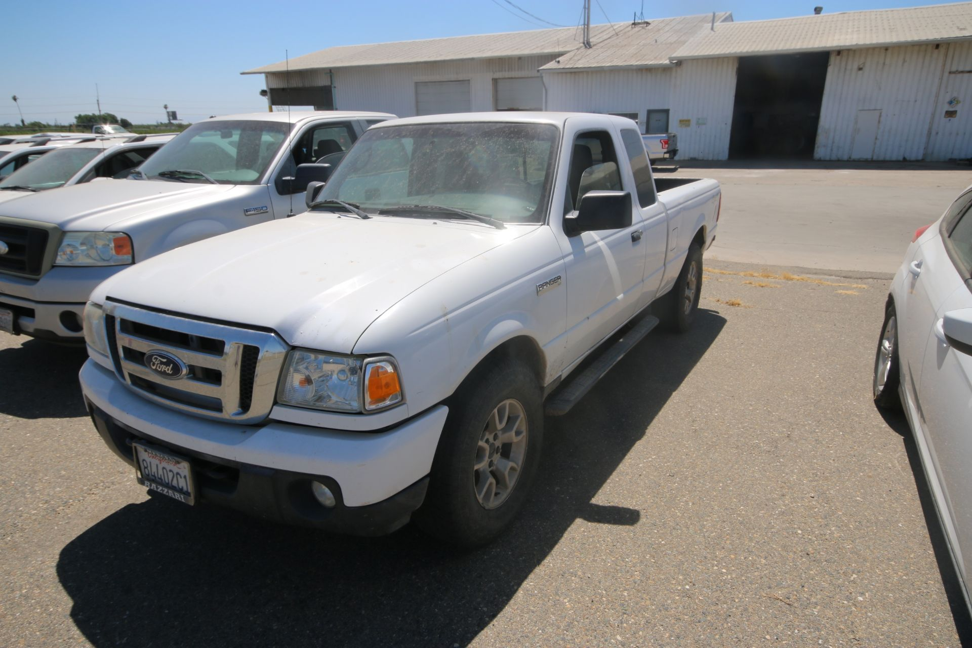 2011 White Ford Ranger Pick Up Truck, VIN #: 1FTLR4FE8BPA37482, with 160,443 Miles, Started Up as of