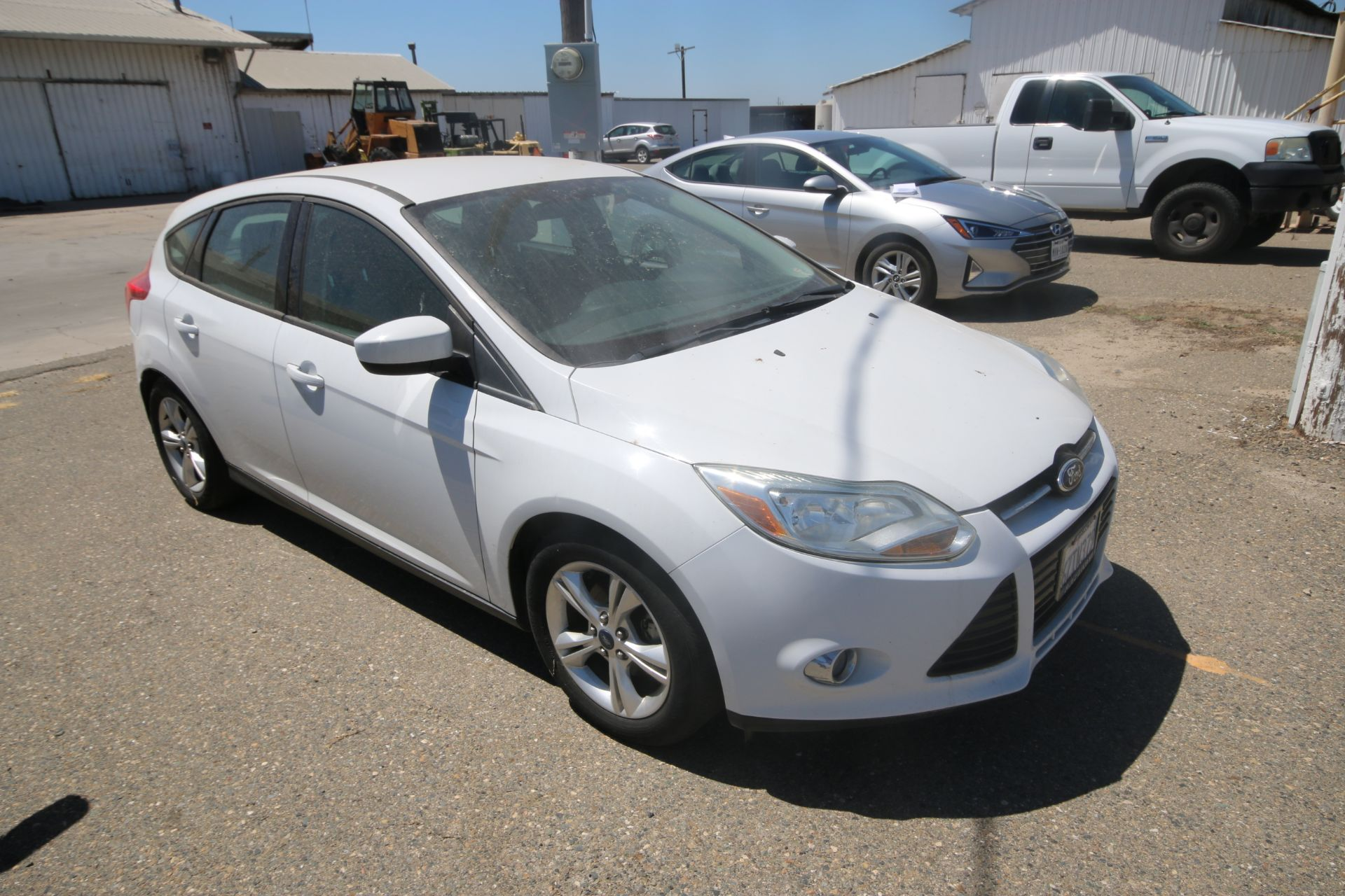 2012 White Ford Focus SE Hatchback 4D, VIN #: 1FAHP3K27CL423326, with 116,017 Miles, with 4-Doors, - Image 2 of 26