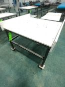 (1) S/S TABLE WITH PLASTIC CUTTING BOARD TOP MOUNTED ON CASTERS APPX L38'' X W38'' (1) S/S TABLE