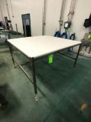 S/S TABLE WITH PLASTIC CUTTING BOARD TOP APPX L60'' X W60'' (LOAD & RIG FEE $50.00 - OPTIONAL