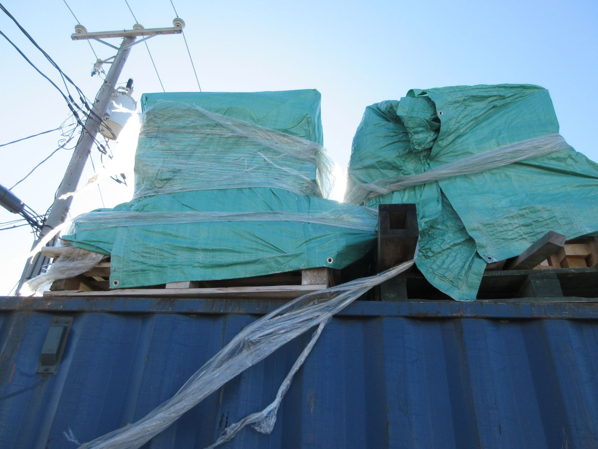 Lot 180 - LOT including (4) pallets of assorted wood c/w tarps