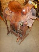 """14"""" VINTAGE STOCK SADDLE W/ 14"""" FORKS, RAWHIDE WRAPPED HORN, CIRCA 1950'S"""