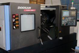 "2012 DOOSAN PUMA 2600, BOX WAYS FANUC CONTROL, 10"" CHUCK, TOOL PRESETTER, 12 POSTIITON TURRET"