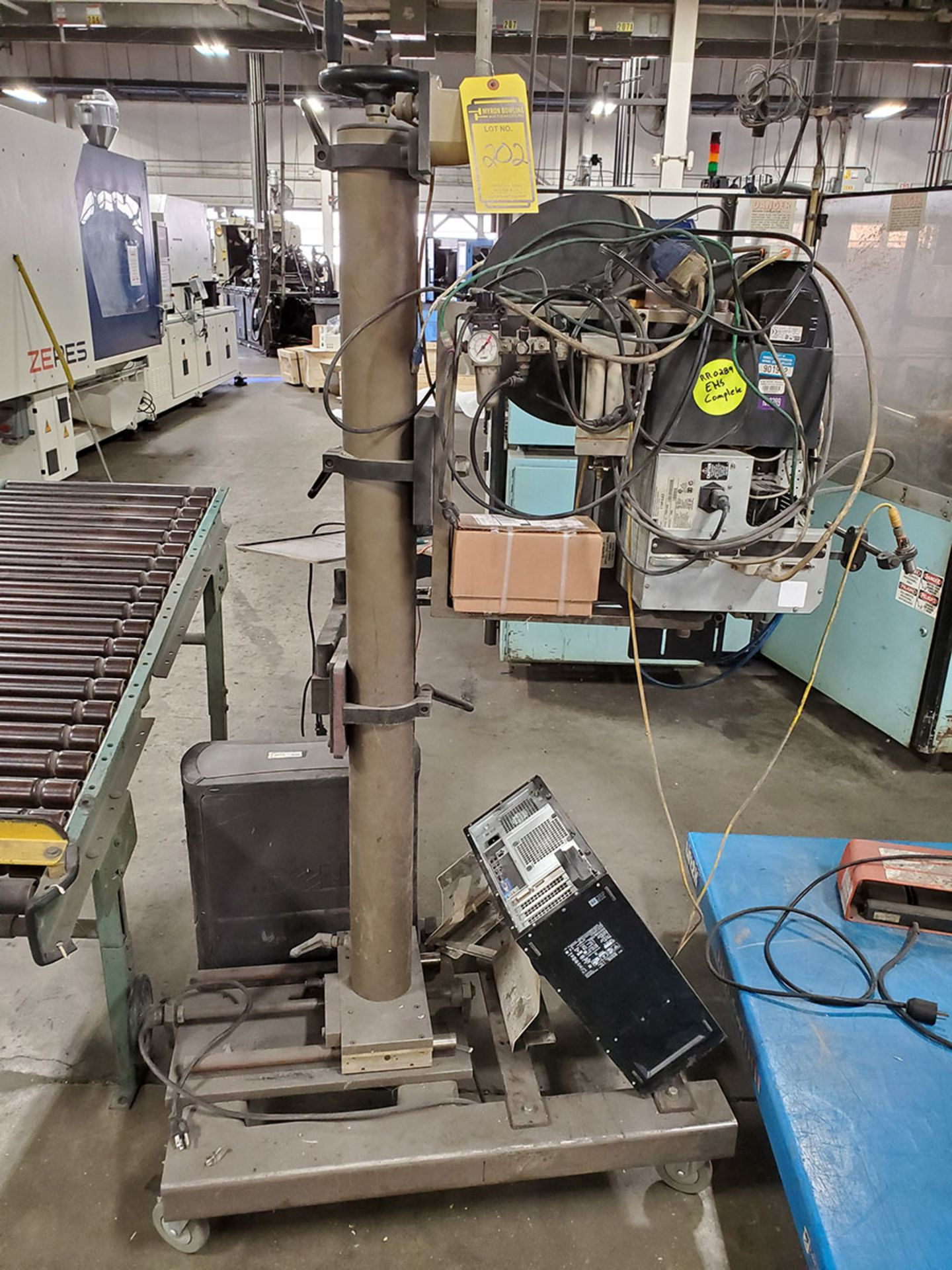 Lot 202 - LOT OF (2) BETTER PACK 555E ELECTRONIC TAPE DISPENSERS & ACTION GSC LABELER ON ROLLING STAND