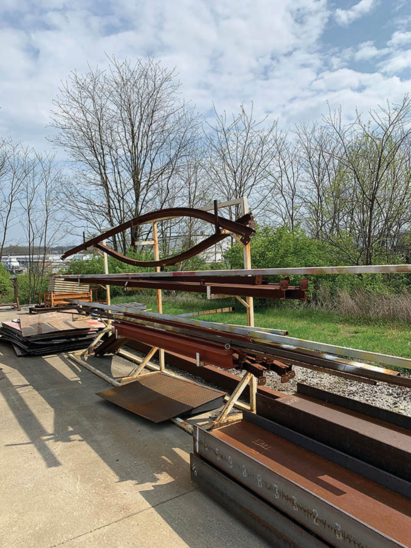Lot 326 - ASSORTED STEEL ON RACK AND I-BEAM ON GROUND