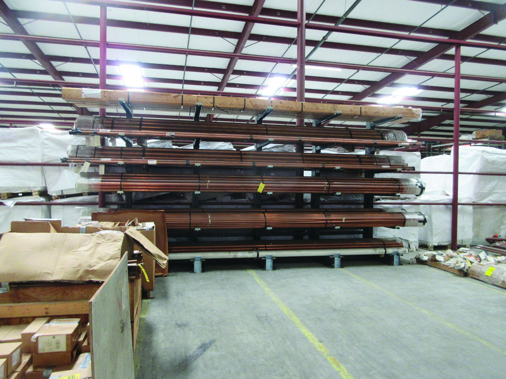 CANTILEVER RACK W/ CONTENT: 120'' X 48'' X 202'', BUNDLES OF COPPER PIPE; LARGER BUNDLES WEIGH 1,